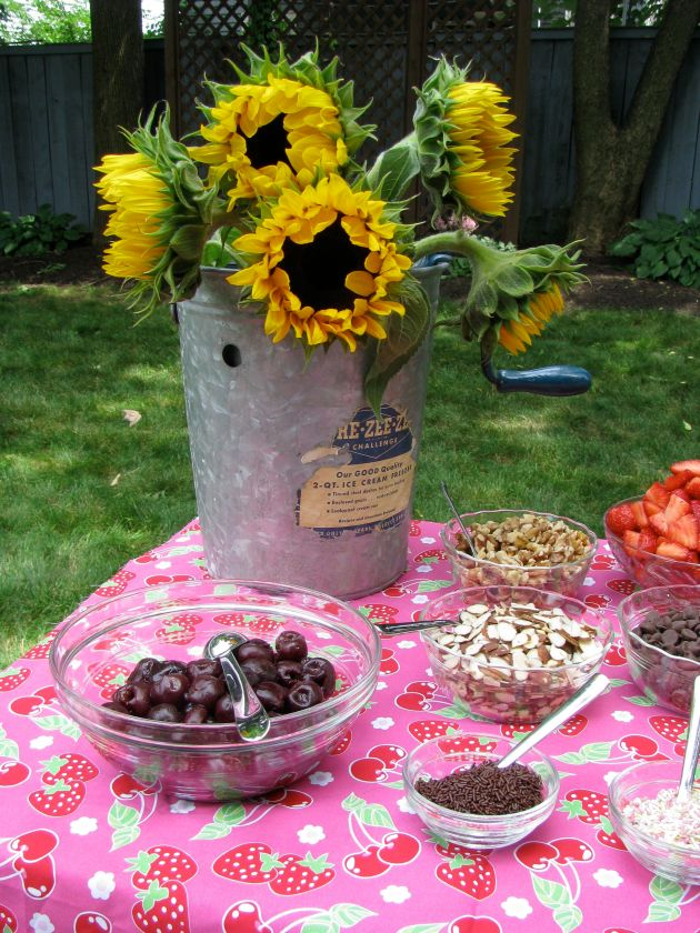 An old fashioned ice cream maker was the centerpiece filled with sunflowers